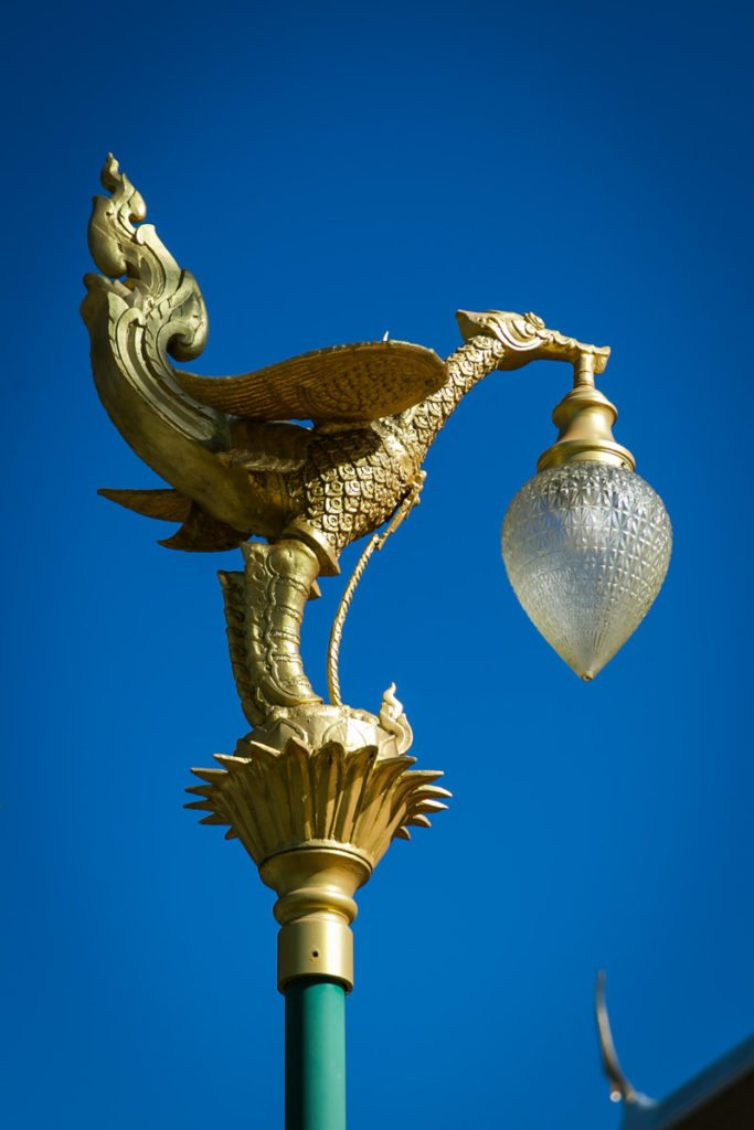 An ornate lamppost at the Wat Mongkolratanaram, photographed by NYC photojournalist, Kelly Williams