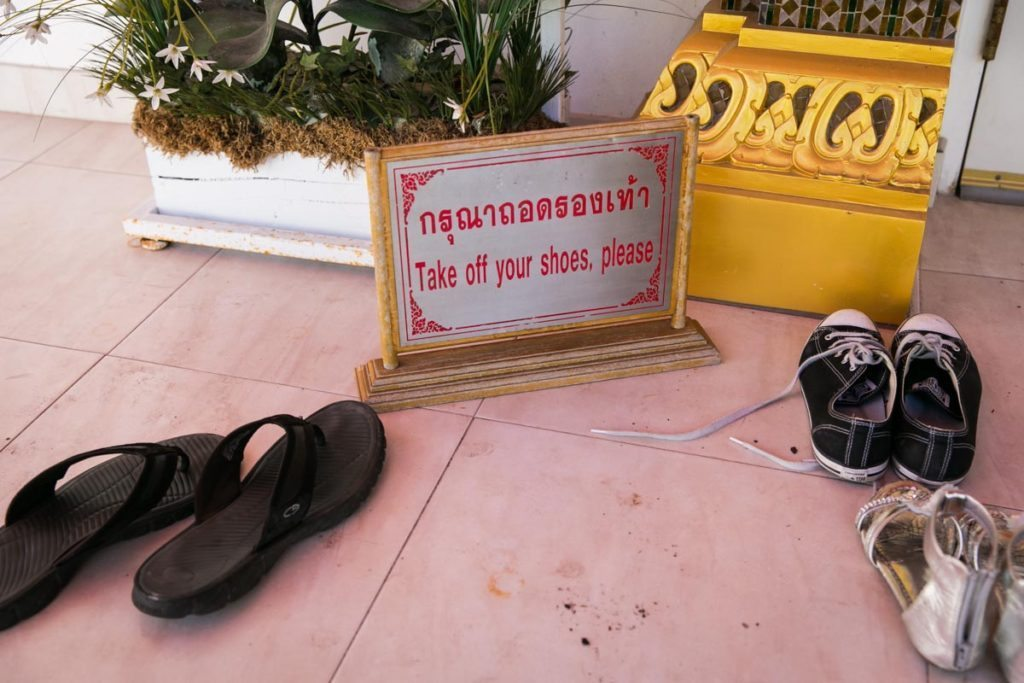 No shoes allowed in the Wat Mongkolratanaram, photographed by NYC photojournalist, Kelly Williams