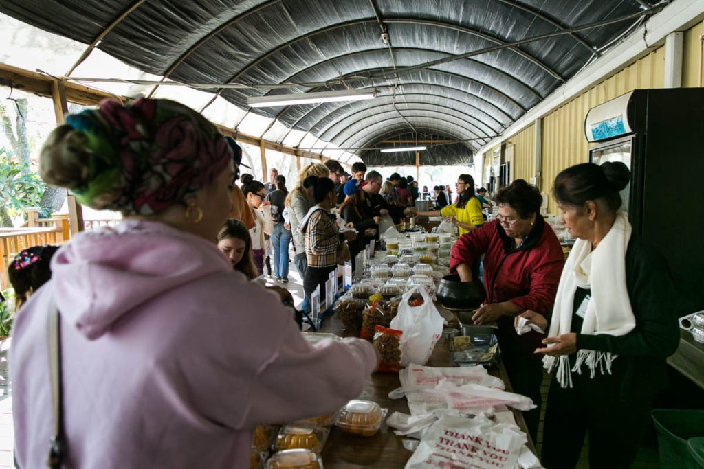 The Asian food market of the Wat Mongkolratanaram, photographed by NYC photojournalist, Kelly Williams