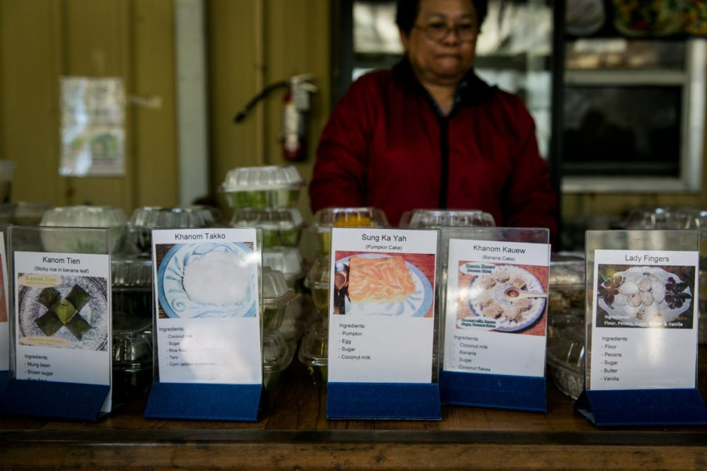 Today's menu items at the Asian food market of the Wat Mongkolratanaram, photographed by NYC photojournalist, Kelly Williams