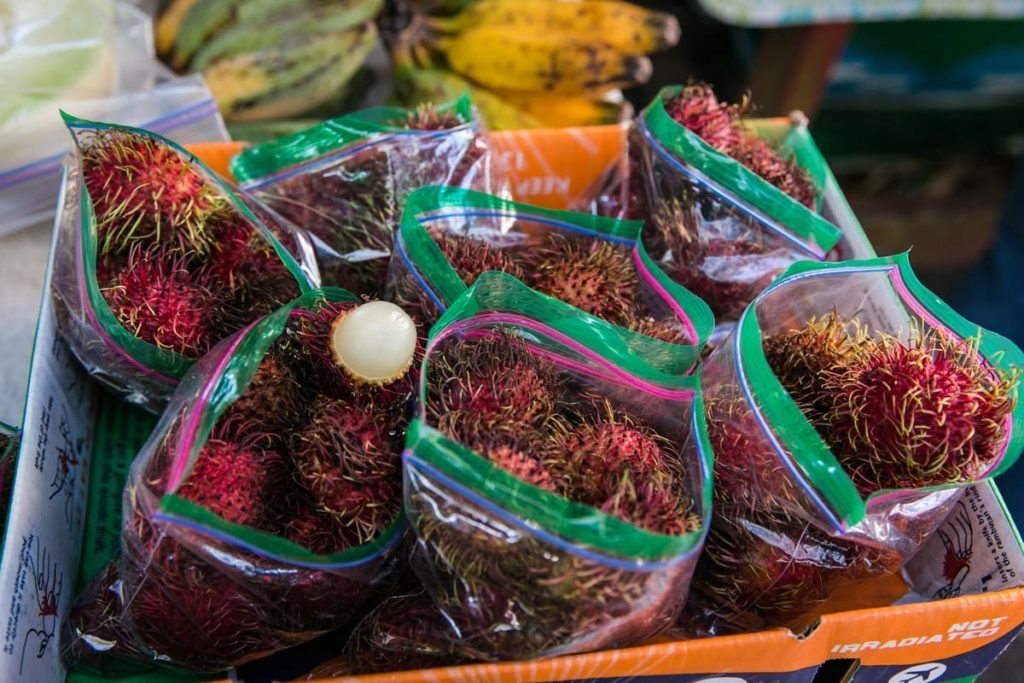 Rambutans for sale at the Wat Mongkolratanaram, photographed by NYC photojournalist, Kelly Williams