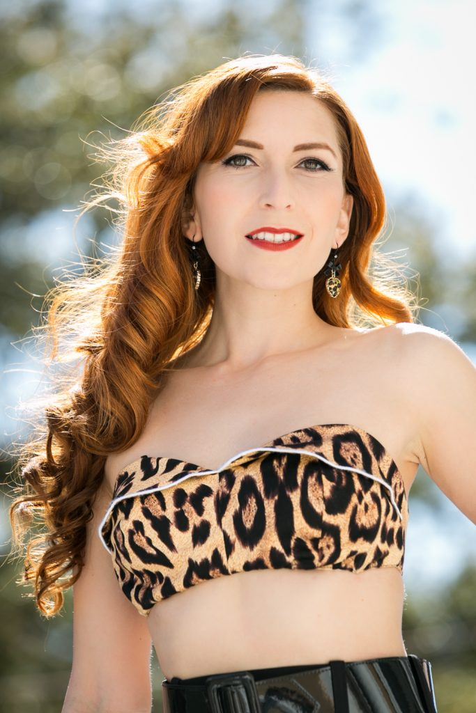 Pinup model wearing leopard print bikini top
