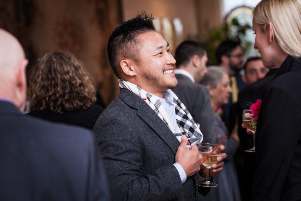 Asian American guest enjoying Alger House wedding reception