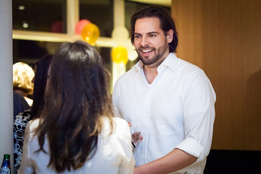 Birthday party photos of handsome man in white shirt