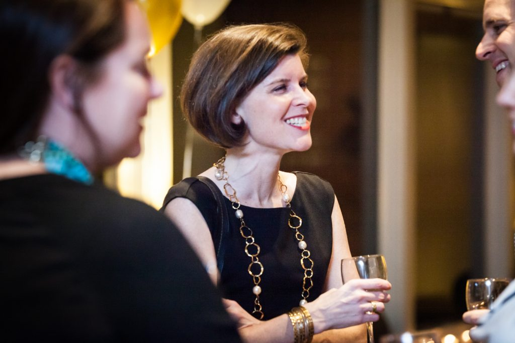 Birthday party photos of woman with short brown hair smiling
