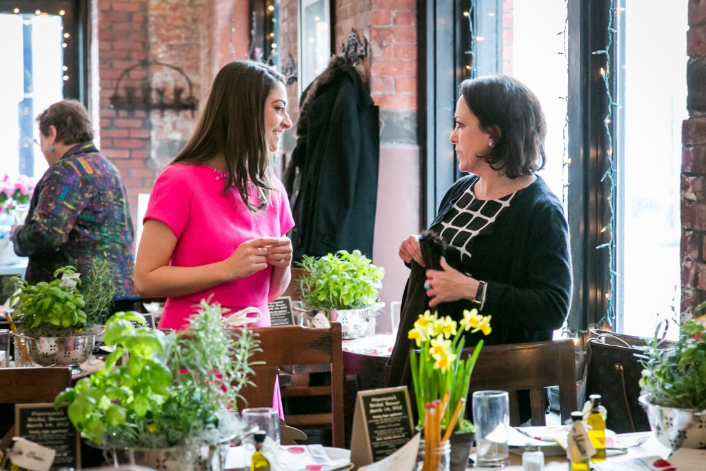 Bride and guest chatting at a NYC bridal shower