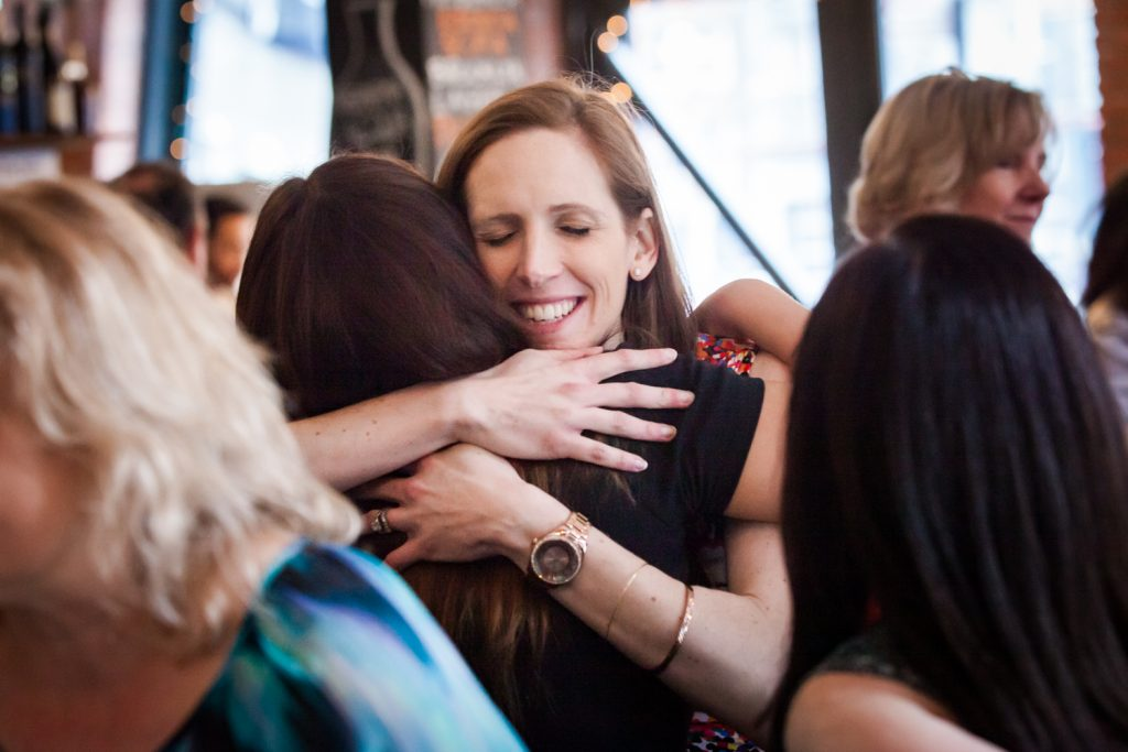 Guests hugging at a NYC bridal shower