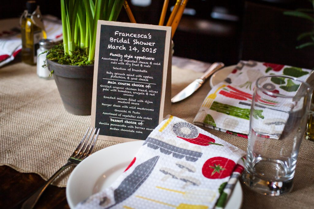 Table setting with menu card and kitchen towel
