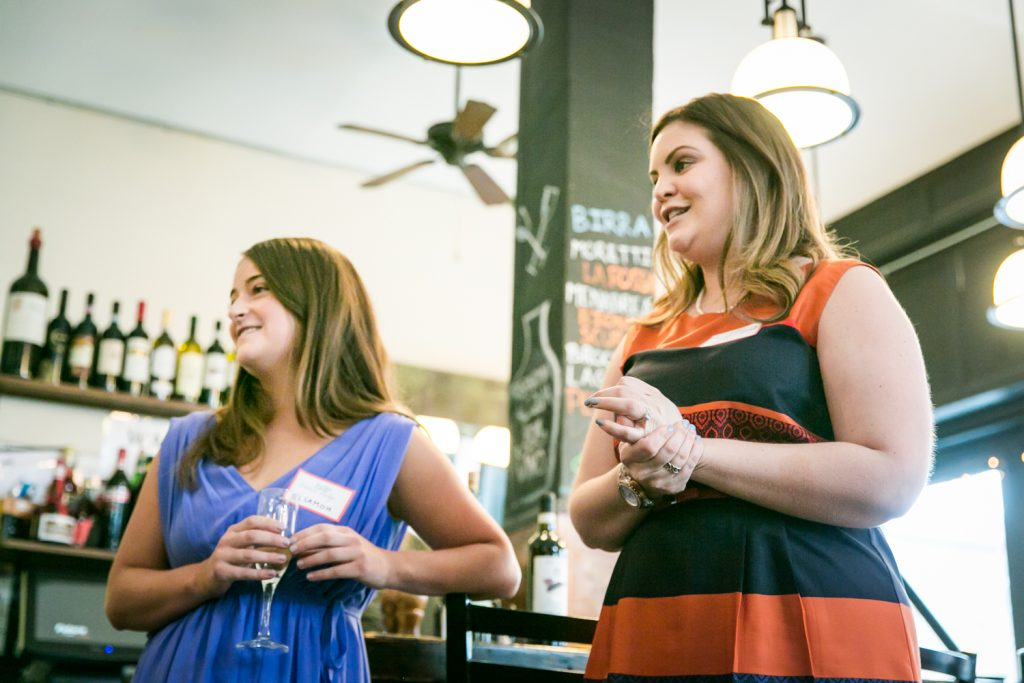 Two women making speech at a NYC bridal shower