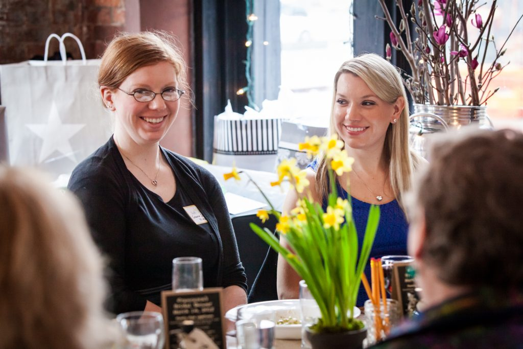 Two women smiling at a NYC bridal shower
