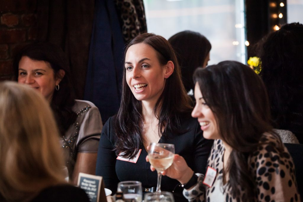 Female guests chatting at table at a NYC bridal shower