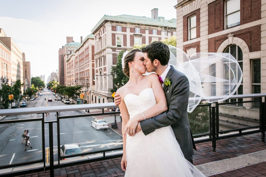 Bride and groom kissing on NYC rooftop for an article on how to get the wedding photos you want