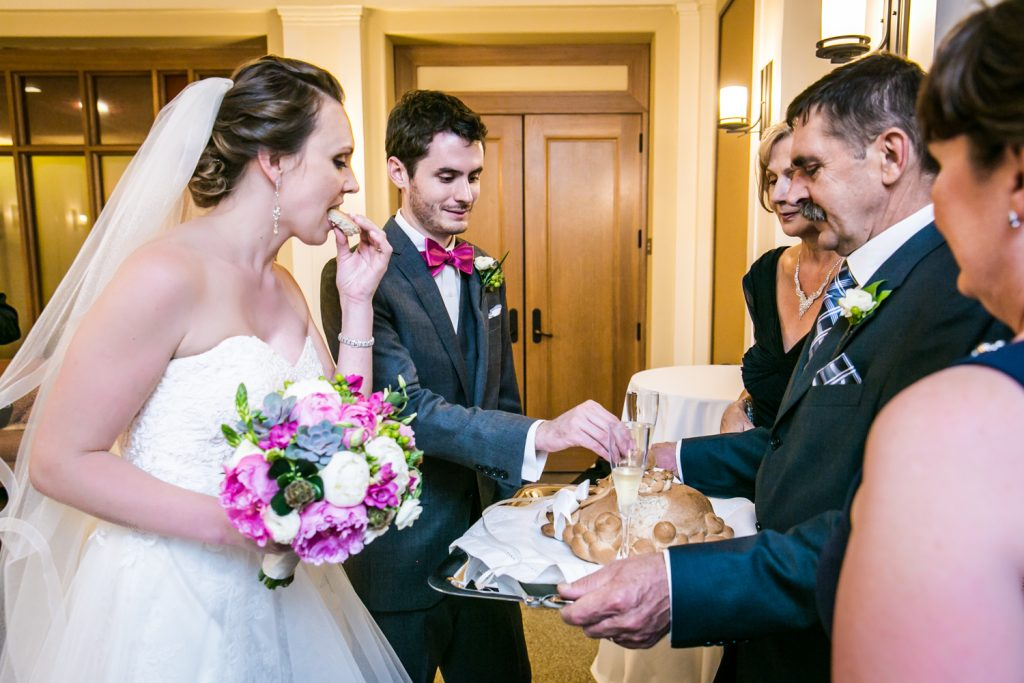 Bride and groom accepting bread and salt from bride's parents