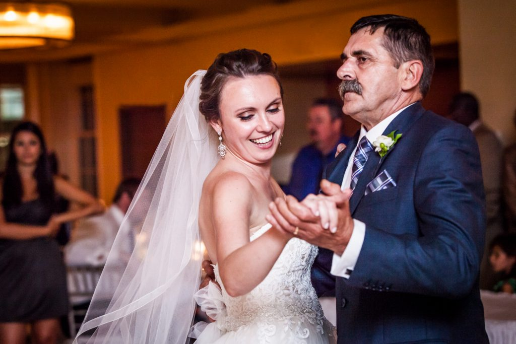 Bride dancing with her father for an article on how to get the wedding photos you want