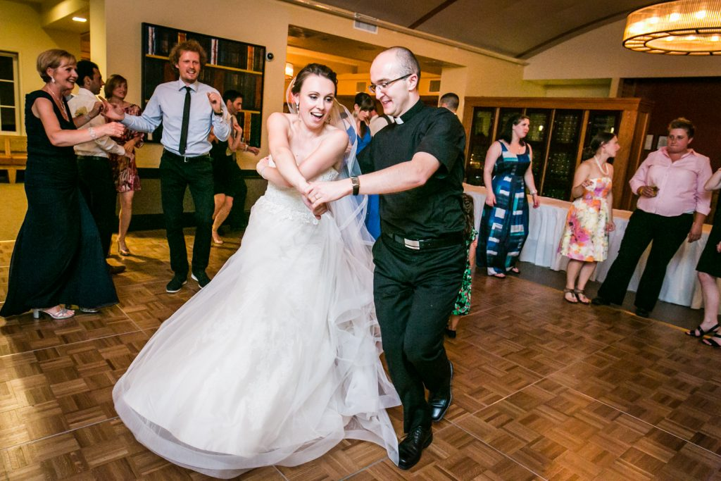 Bride dancing with priest for an article on how to get the wedding photos you want