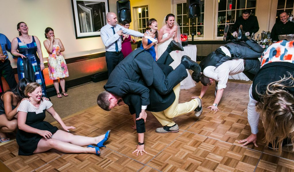 Guests playing games on dance floor at wedding reception