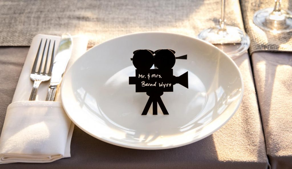 Place setting with mini film camera escort card