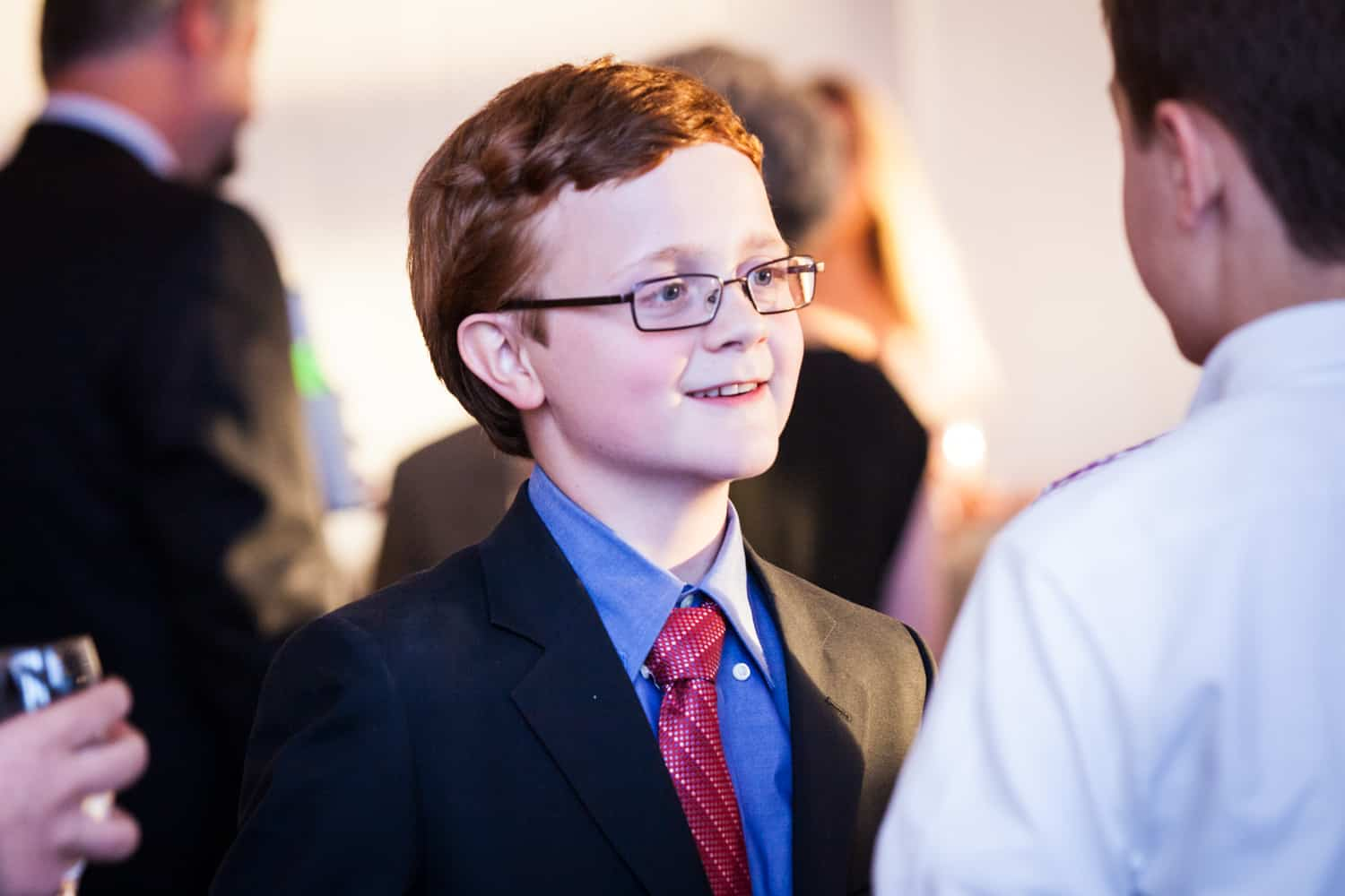 Birthday boy at a bar mitzvah for an article on how to plan the perfect bar mitzvah