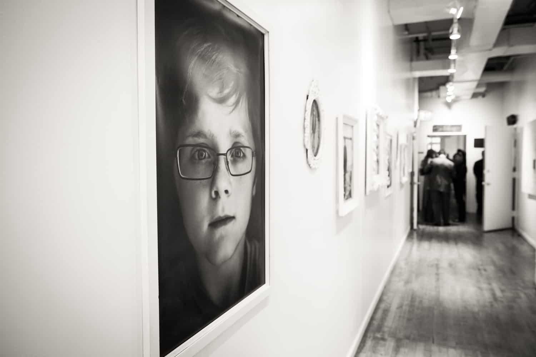 Hallway with photos of birthday boy at Attic Studios