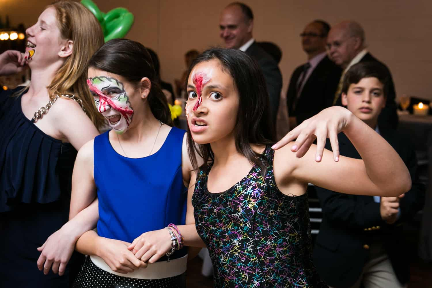 Two girls with zombie face makeup for an article on how to plan the perfect bar mitzvah
