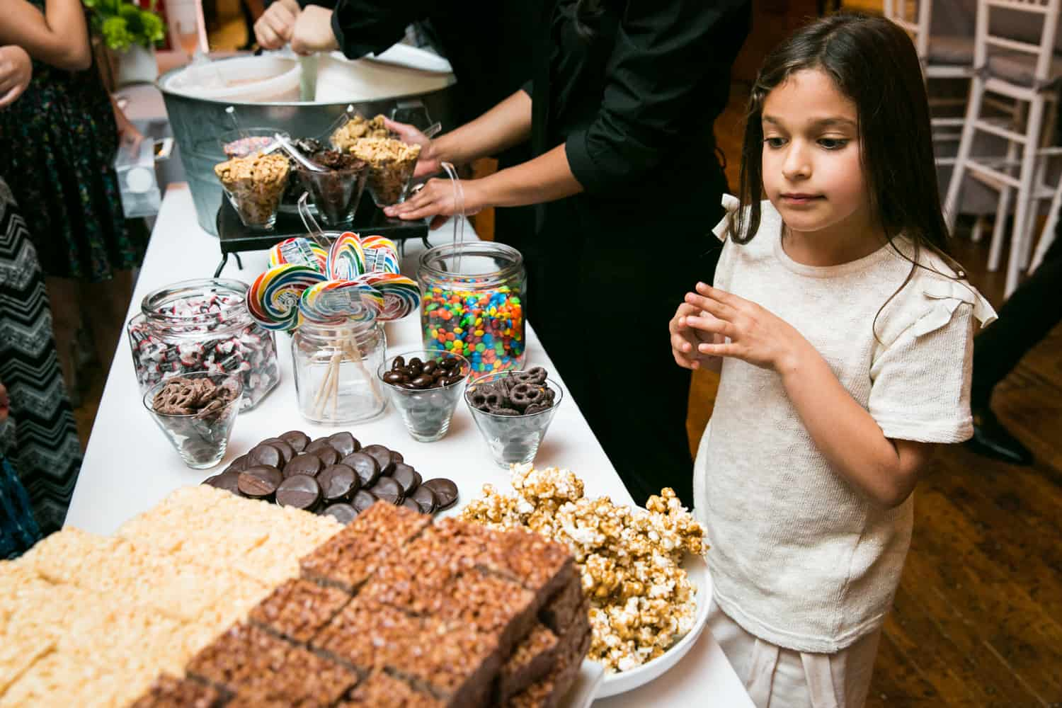 Girl looking at dessert buffet for an article on how to plan the perfect bar mitzvah