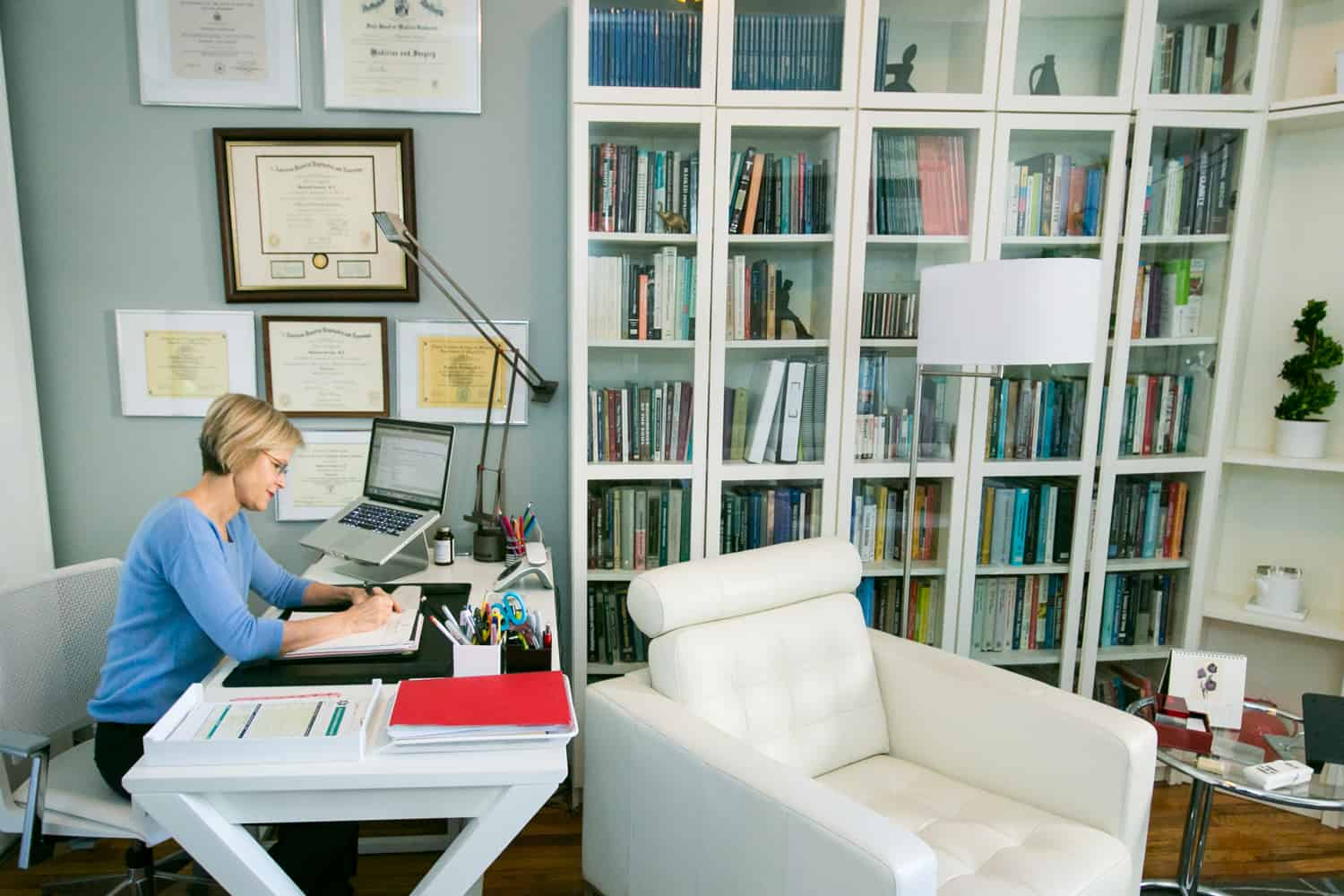 Professional portraits of a psychiatrist at her desk