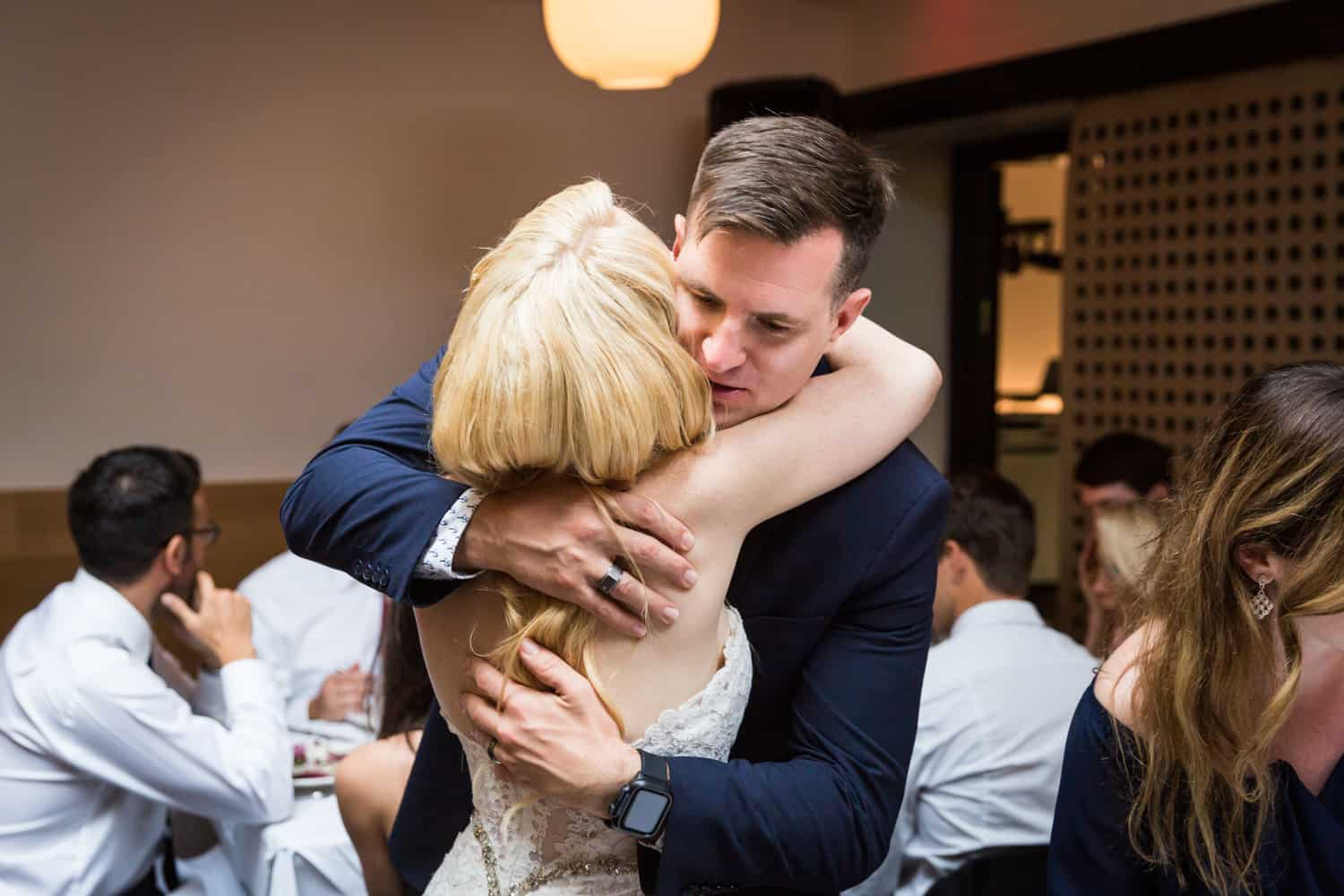 Table shots of bride hugging guest
