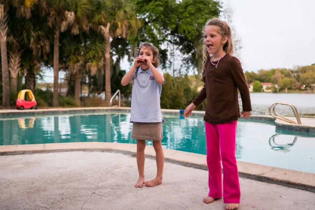Family fun beside the pool by NYC family photojournalist, Kelly Williams, for an article on how to take the best family photos
