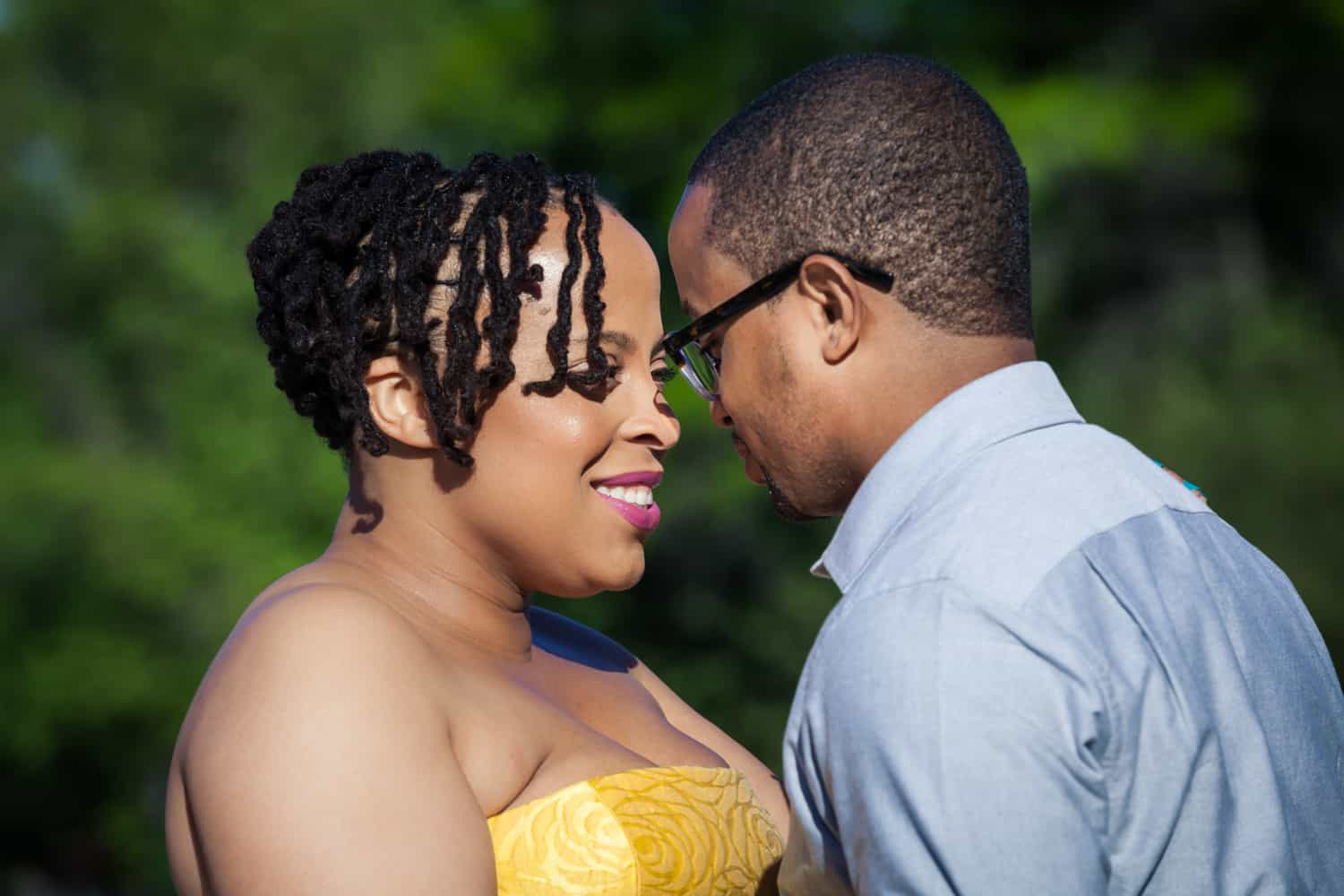 Engaged African American couple touching foreheads