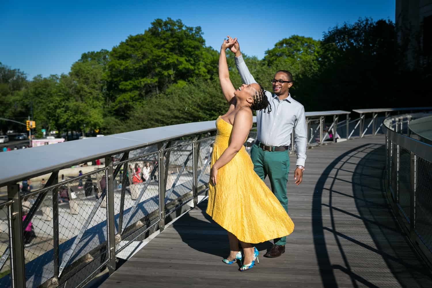 Couple dancing on roof of Brooklyn Musuem at a Brooklyn Museum engagement shoot