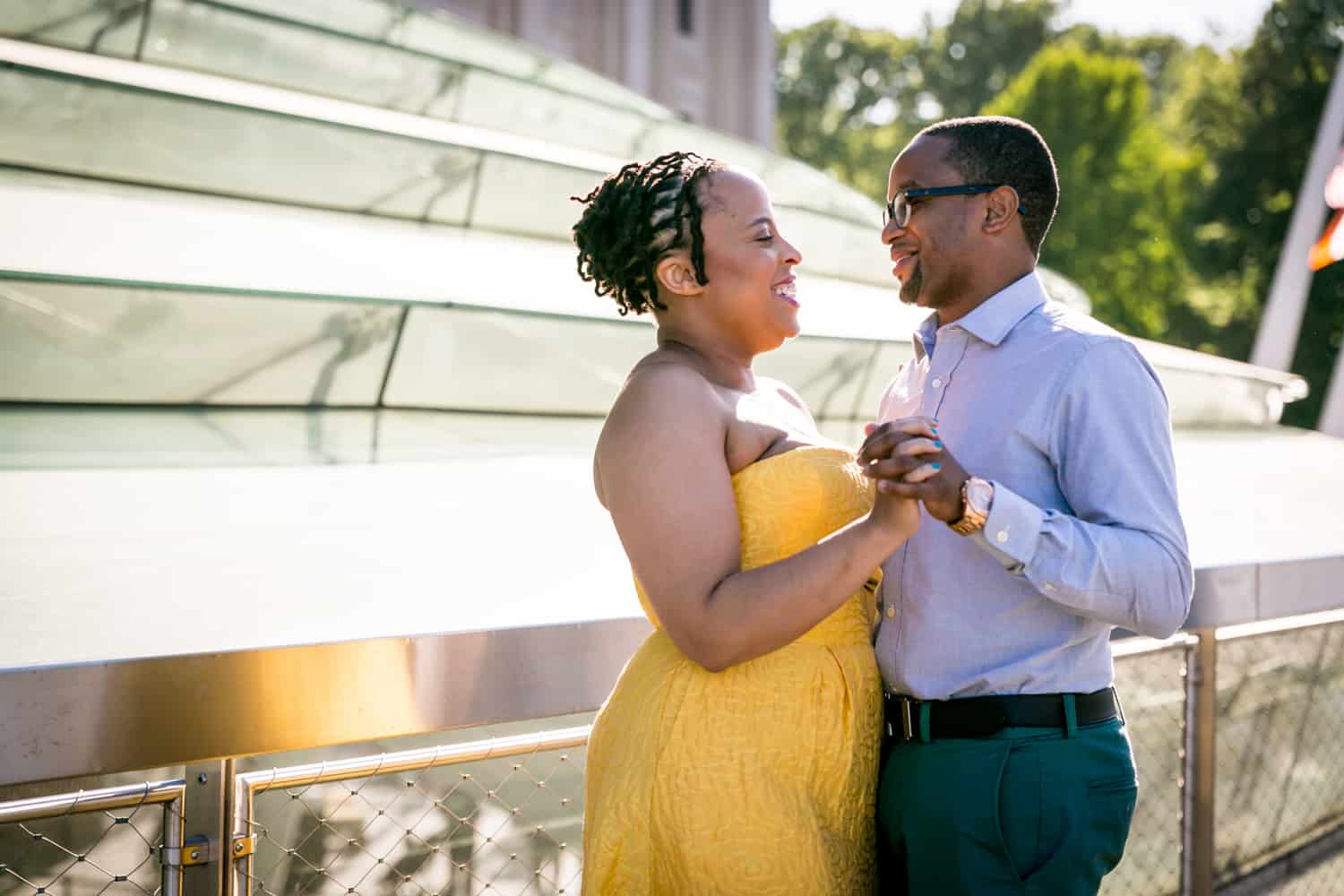 Couple dancing on roof of Brooklyn Museum at a Brooklyn Museum engagement shoot