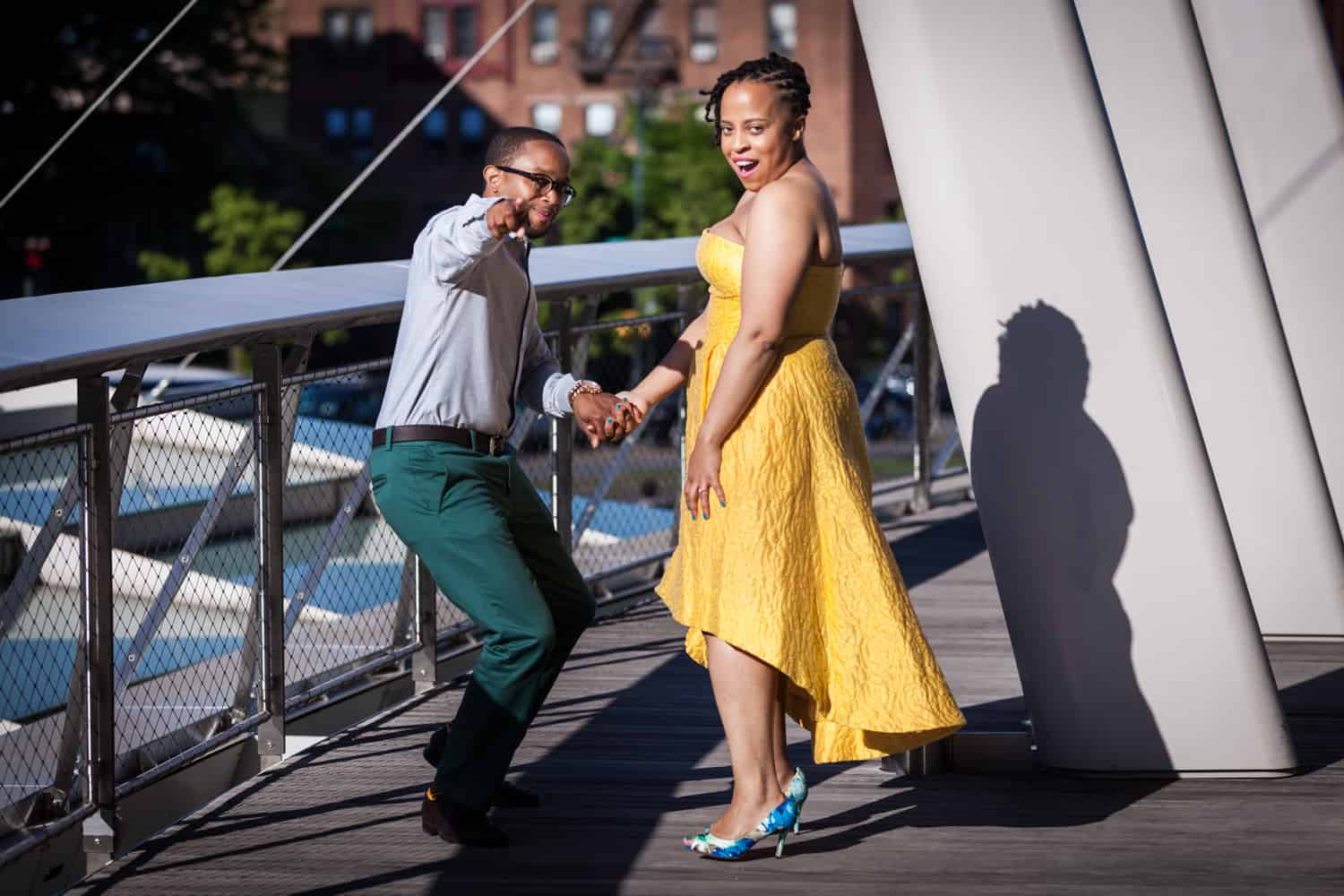 Couple pointing to camera at a Brooklyn Museum engagement shoot