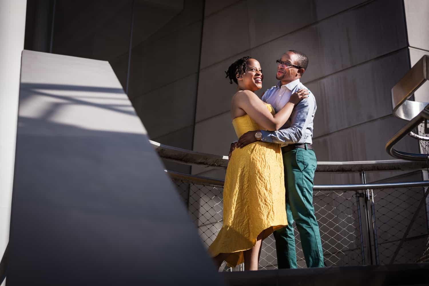 Couple standing on Brooklyn Museum steps at a Brooklyn Museum engagement shoot