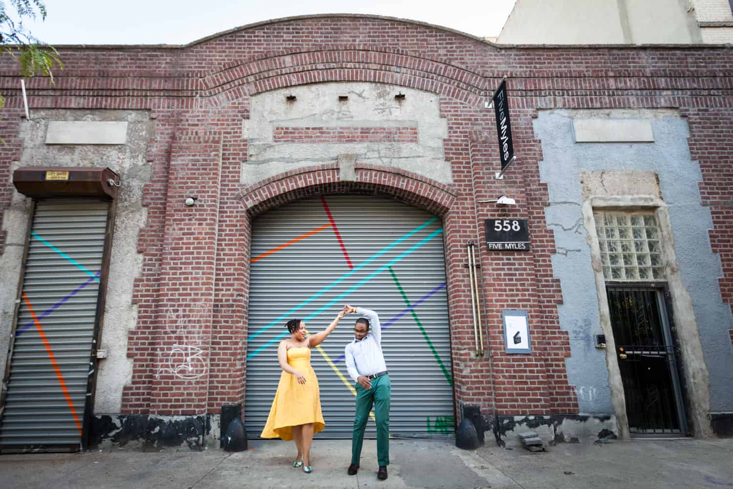 Couple dancing in front of Five Myles gallery in Brooklyn