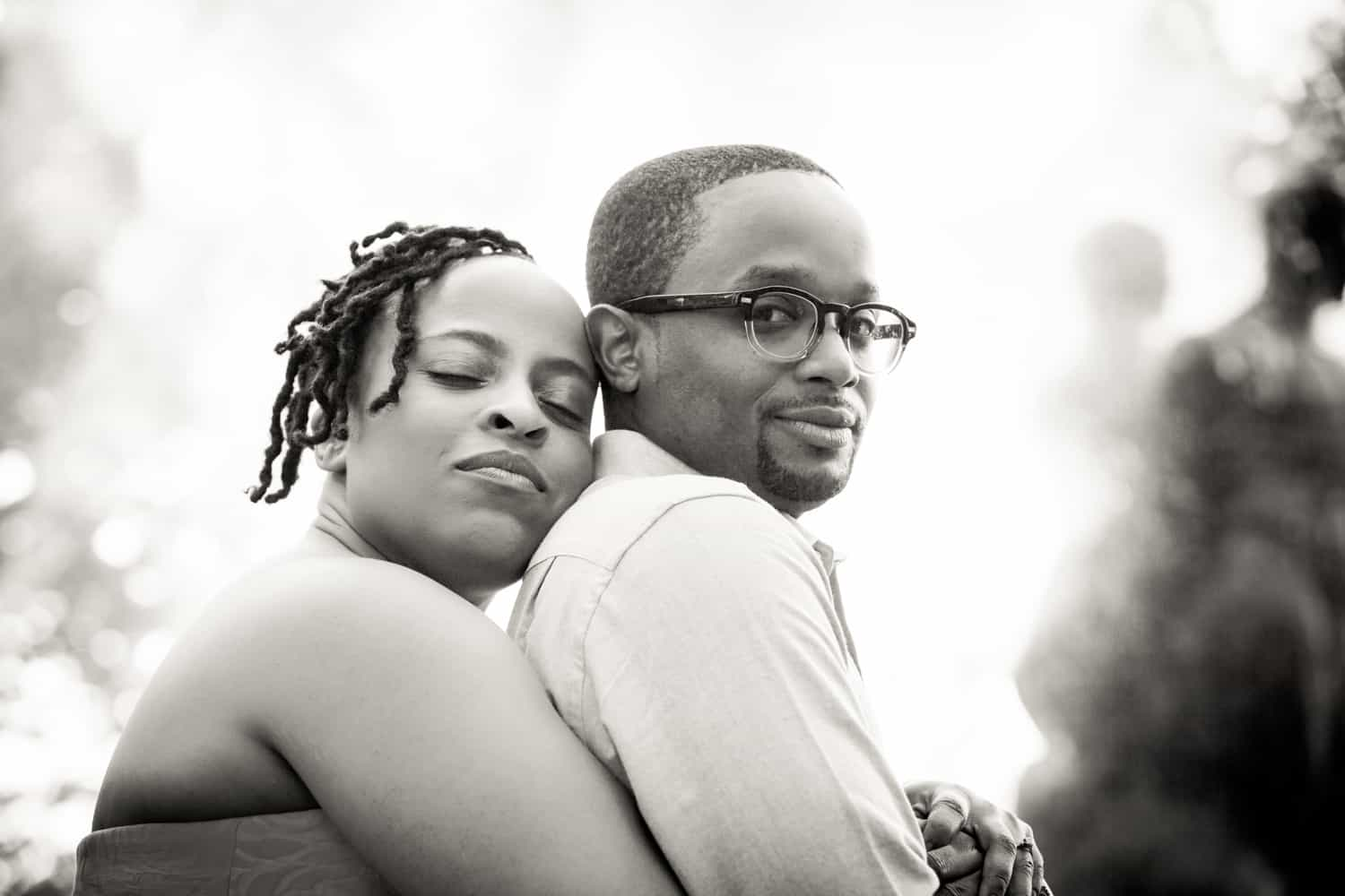 Black and white photo of African American couple hugging