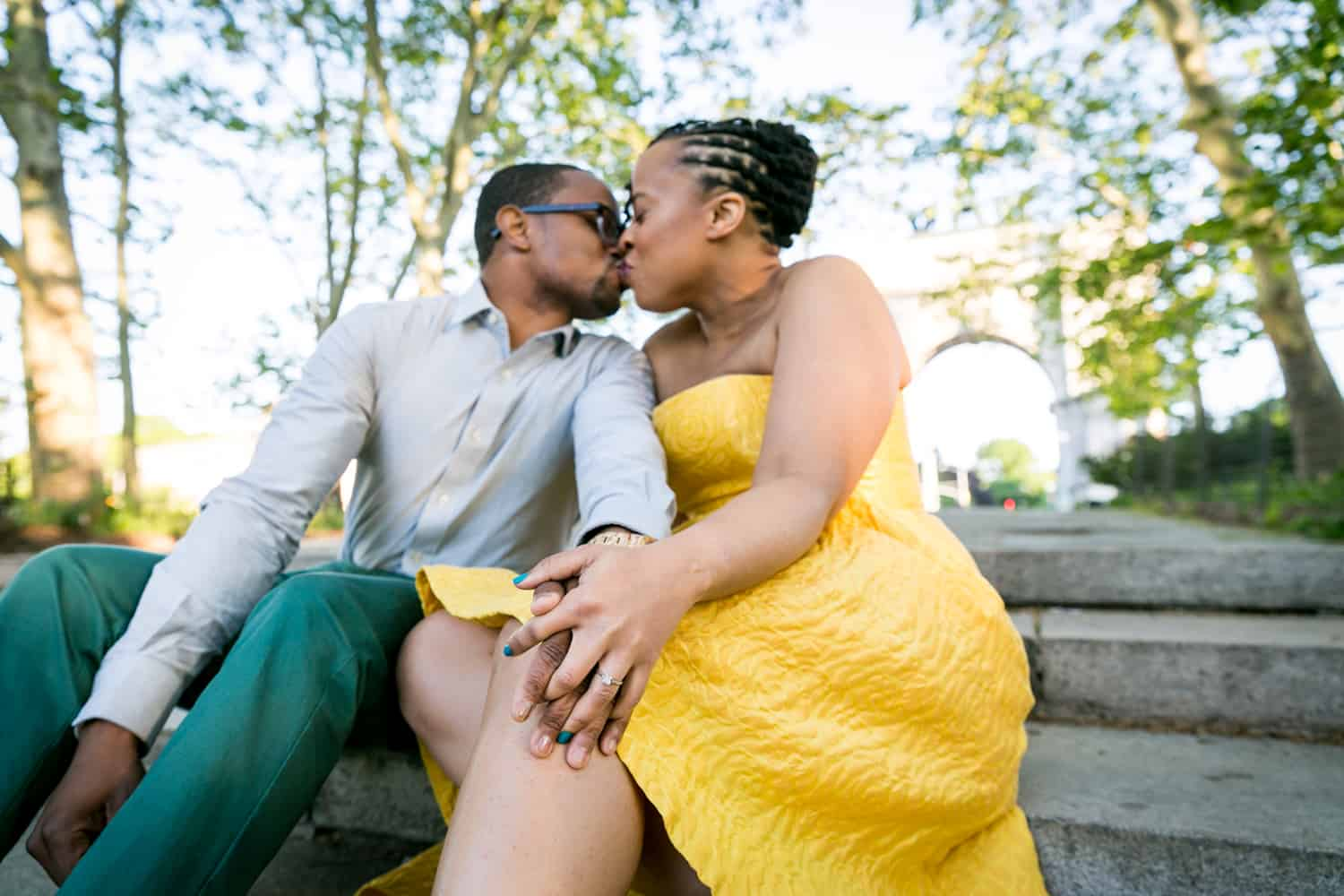 African American couple kissing on steps of Grand Army Plaza