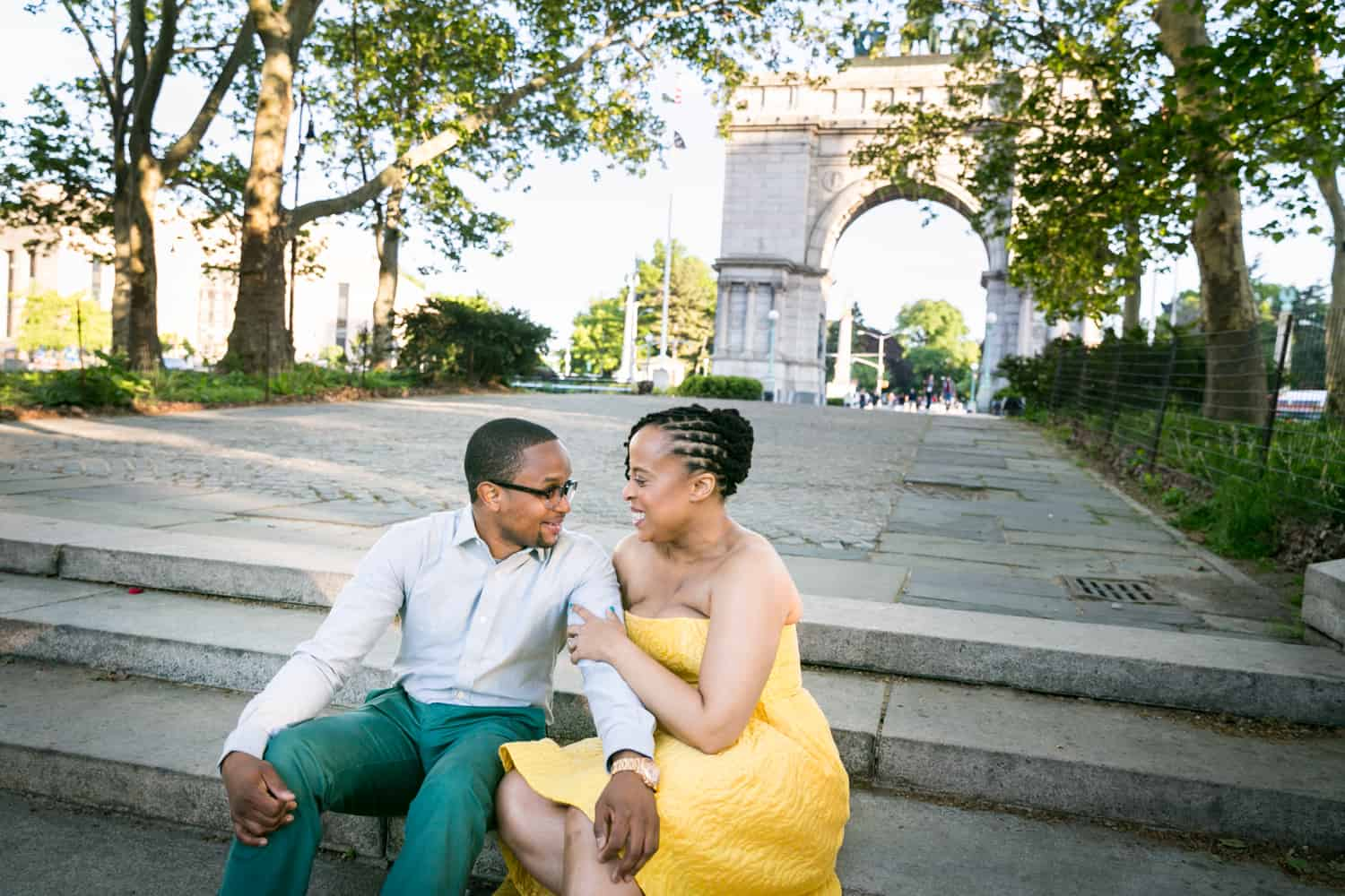 African American couple sitting on steps of Grand Army Plaza