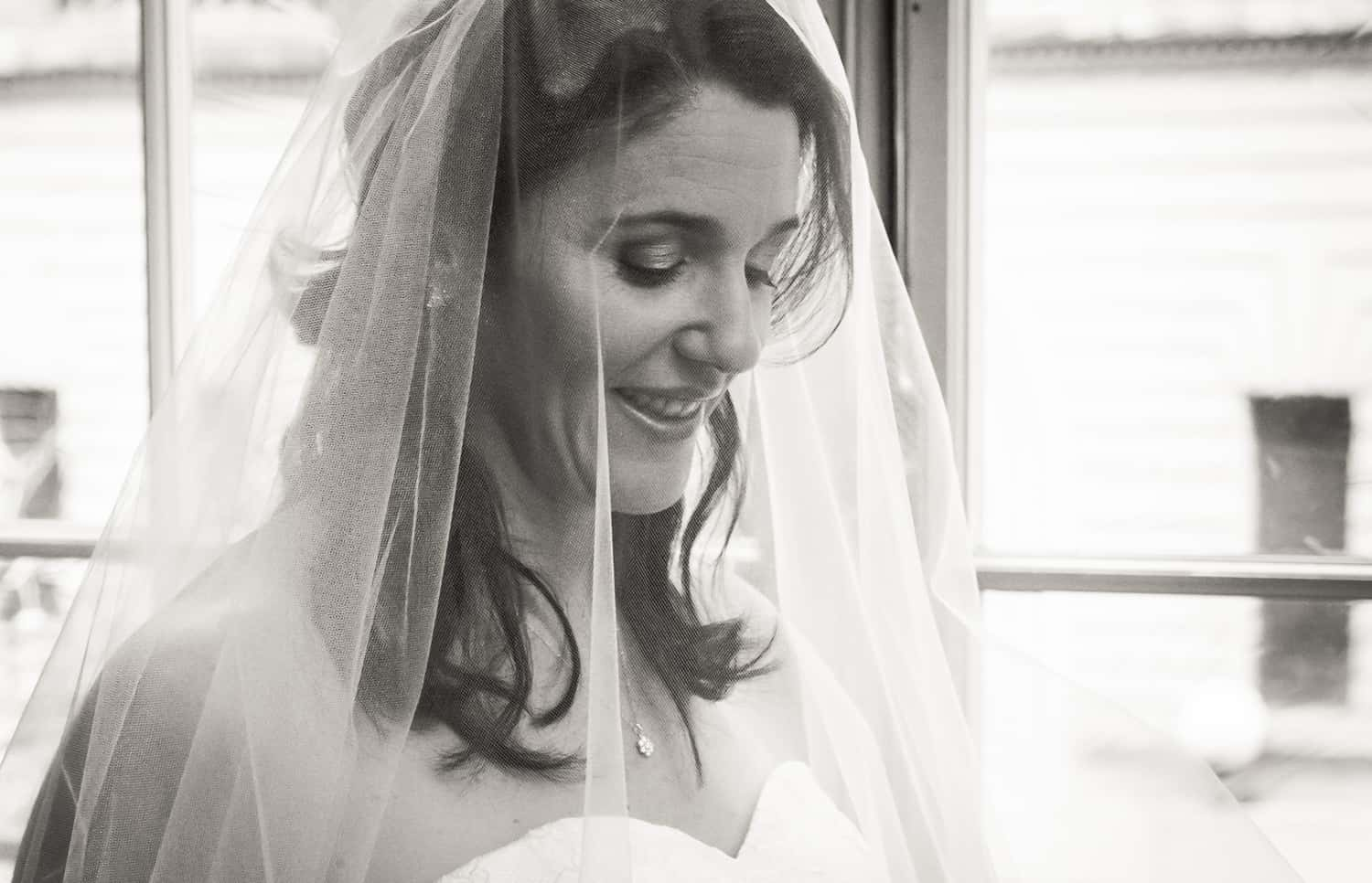 Black and white photo of bride wearing veil before a Harvard Club wedding