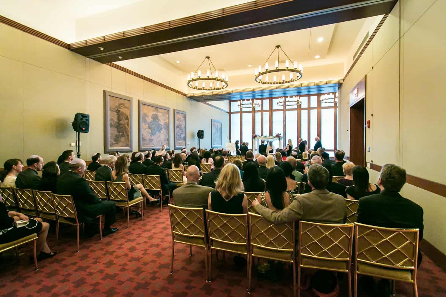 Wide shot of room during Harvard Club wedding ceremony