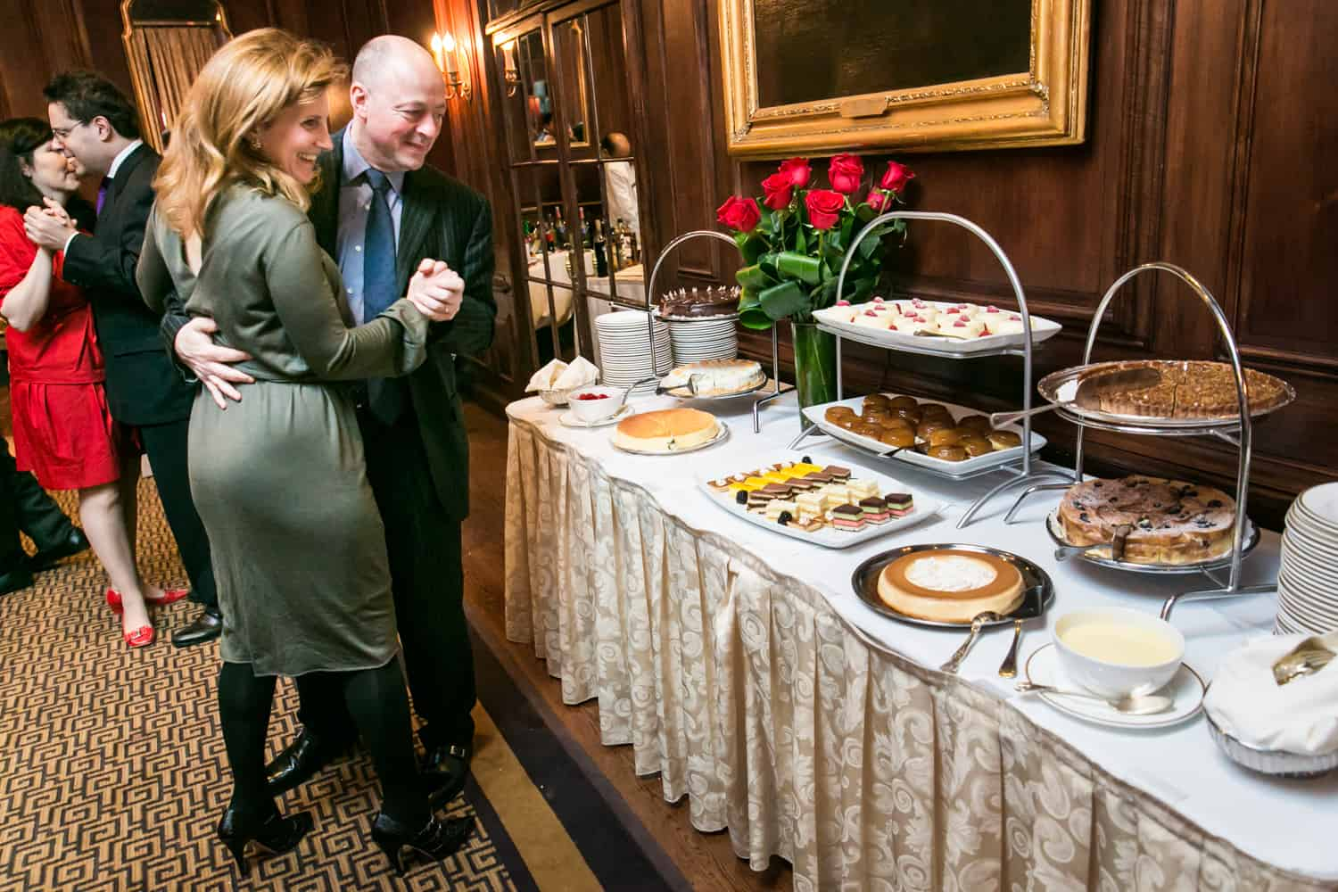 Dancing guests looking at dessert buffet at Harvard Club wedding