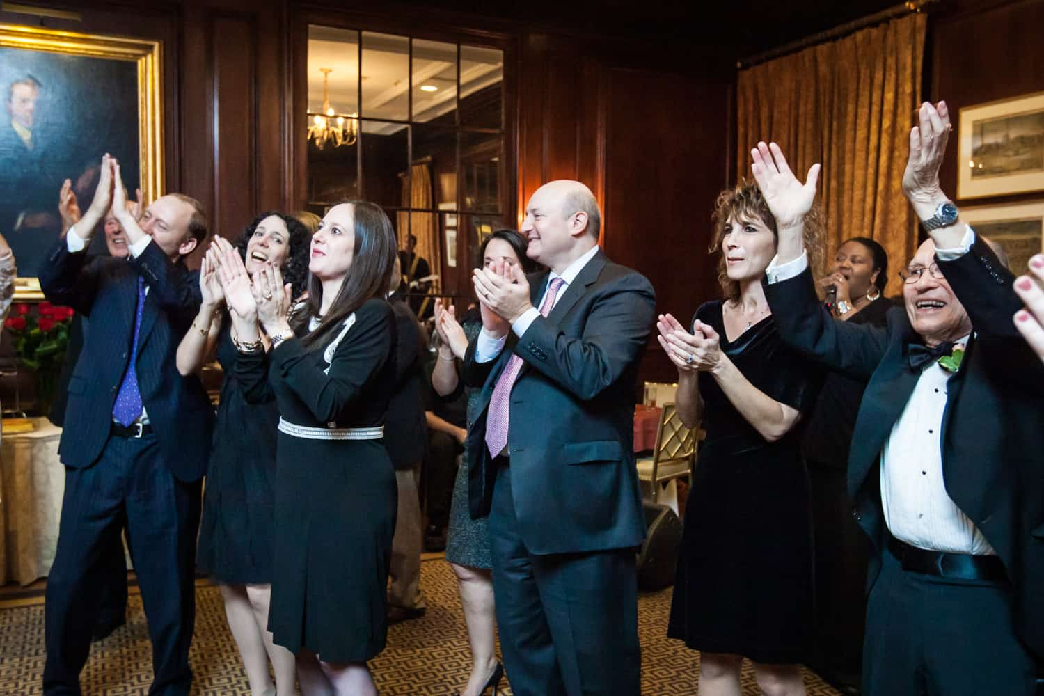 Guests clapping at Harvard Club wedding reception