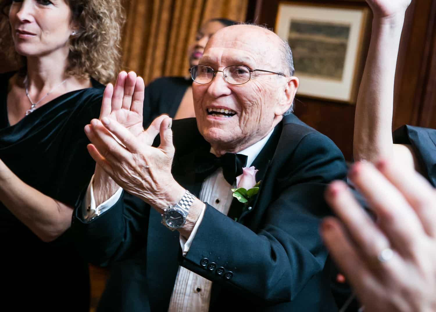 Older man clapping at Harvard Club wedding reception