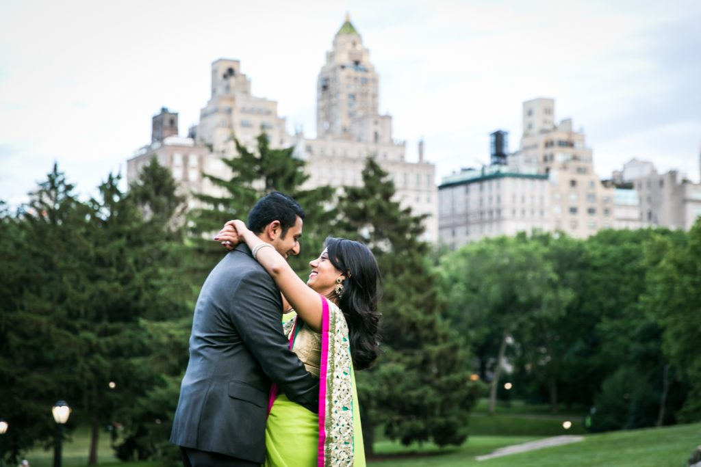 Woman with arms around neck of man in Central Park