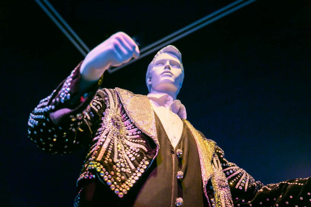Mannequin wearing elaborate, sequined jacket