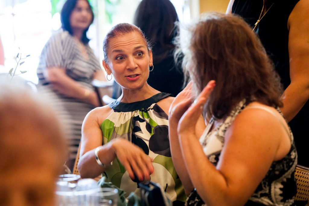 Guests mingling at  the bridal shower by Bay Ridge bridal shower photographer, Kelly Williams