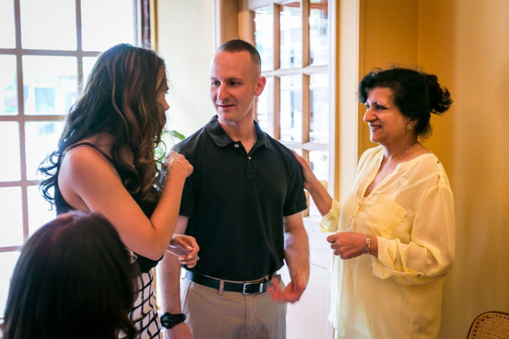 The bride  mingling at  her shower by Bay Ridge bridal shower photographer, Kelly Williams