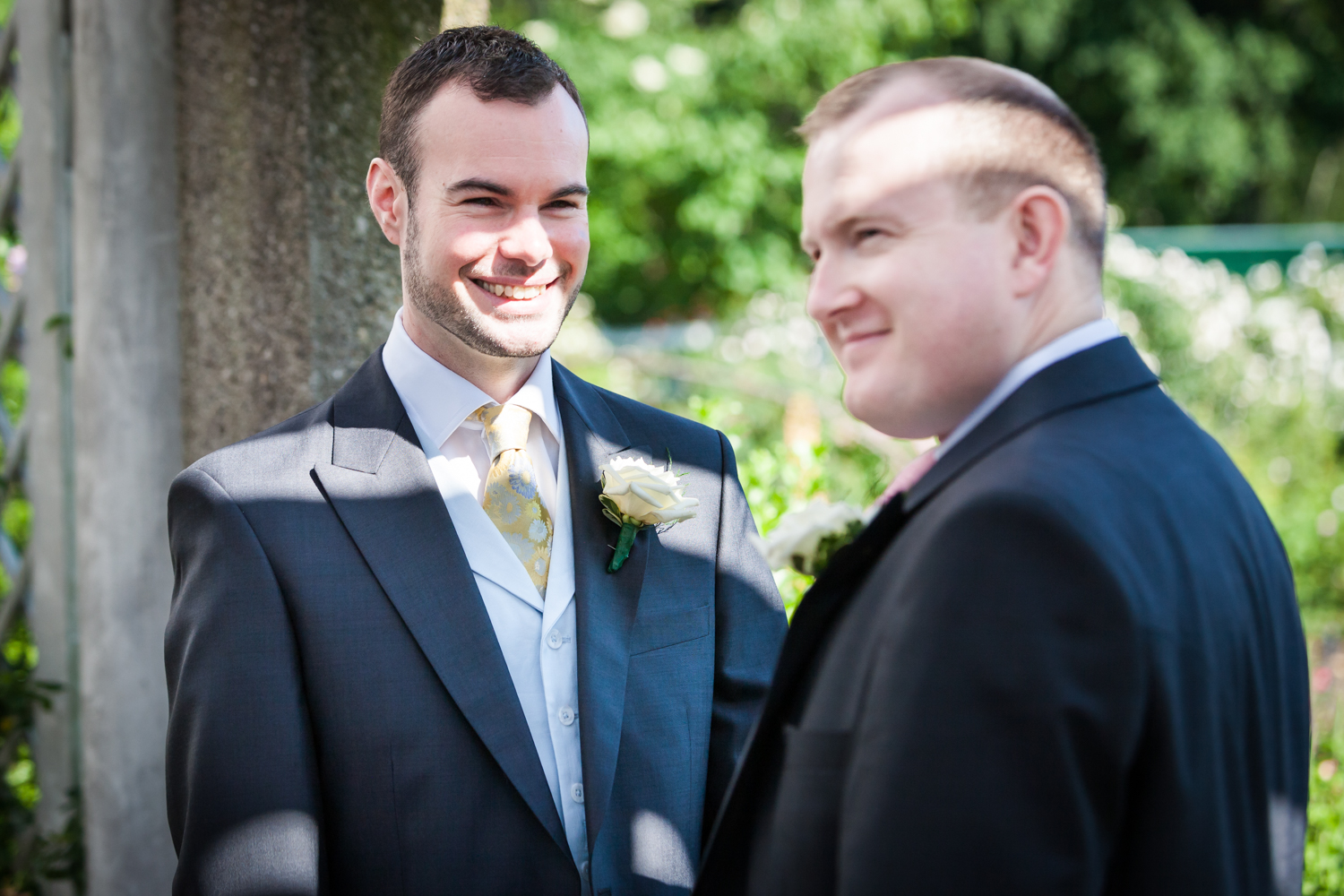 Two grooms exchanging vows at an Brooklyn Botanic Garden wedding