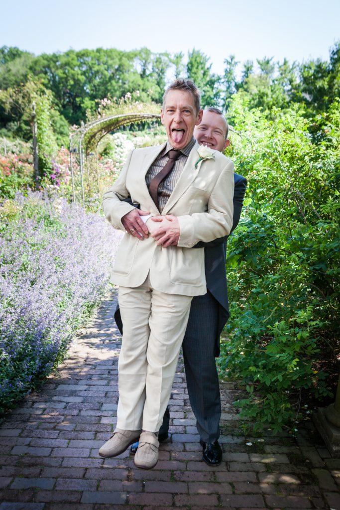 Groom picking guest off the ground at an Brooklyn Botanic Garden wedding