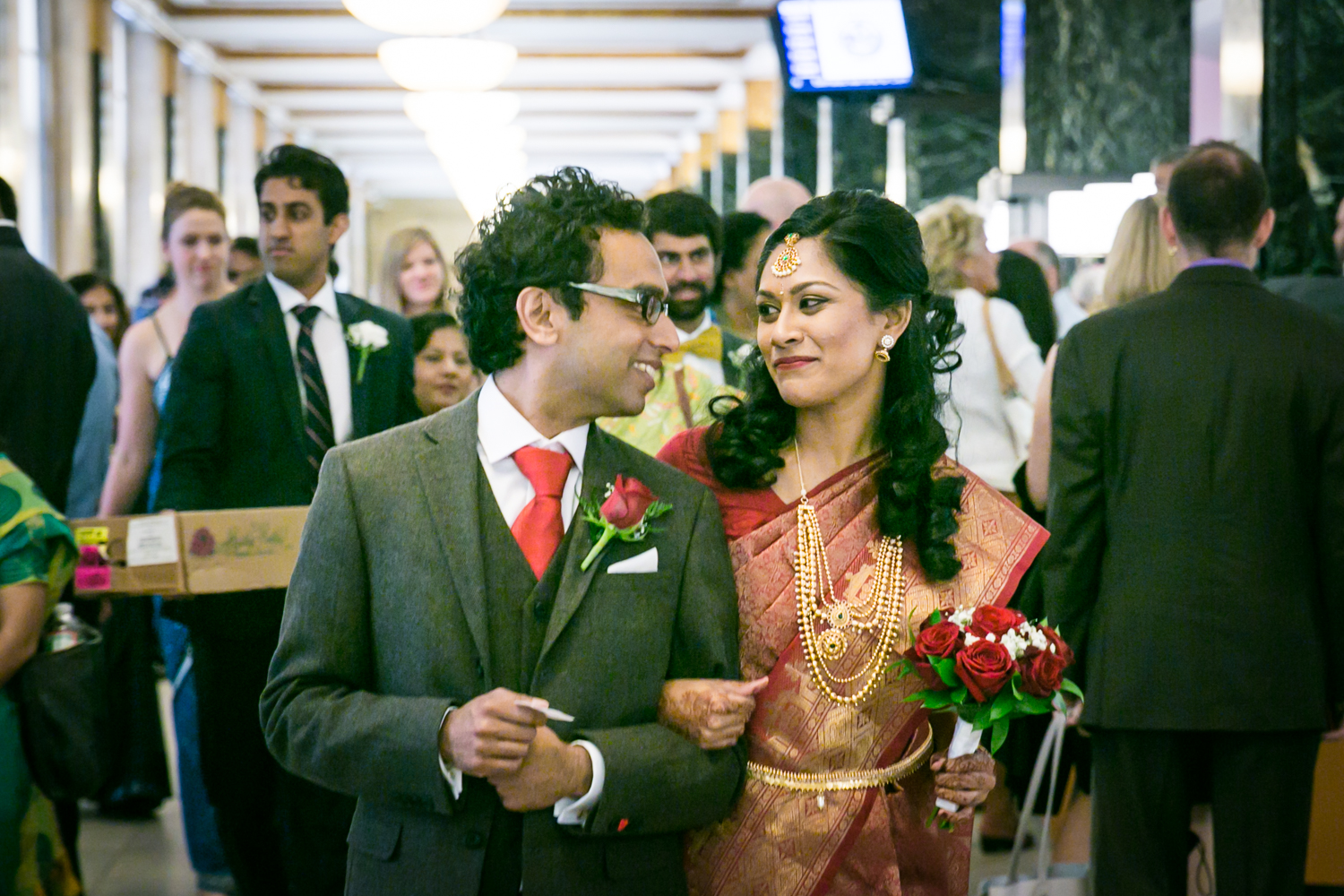 Indian bride and groom walking out of City Clerk's office at a NYC City Hall Indian wedding