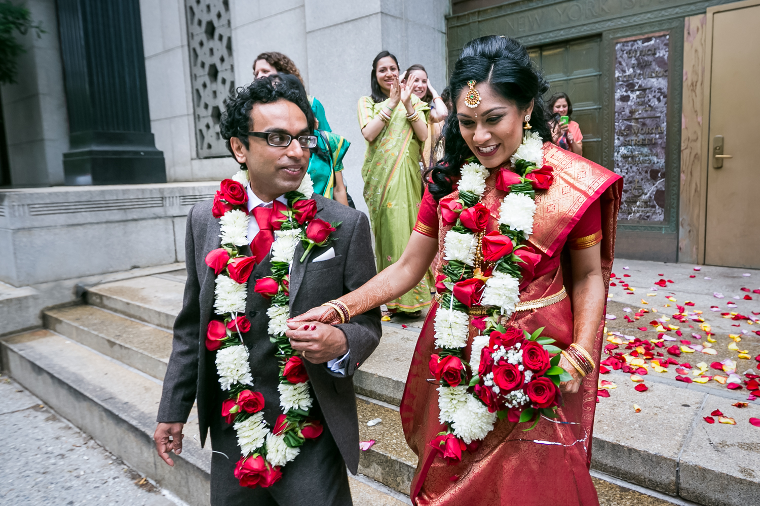 Indian bride and groom leaving City Clerk's office at a NYC City Hall Indian wedding